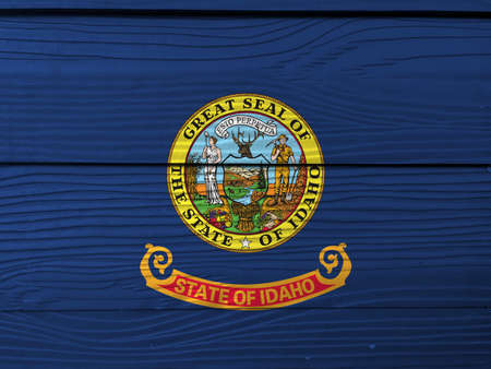 Idaho flag color painted on Fiber cement sheet wall background, state seal of Idaho on a field of blue. The states of America.