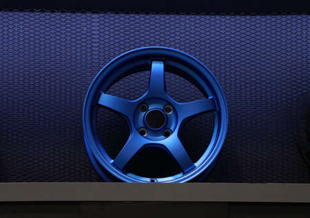 Blue Alloy Wheel of car on the shelf. Alloy wheels are wheels that are made from an alloy of aluminium or magnesium. Alloys are mixtures of a metal and other elements.