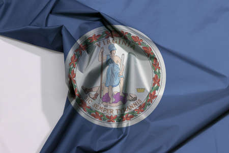 Virginia fabric flag crepe and crease with white space. Obverse of the Seal of Virginia on an azure field. The state os America.