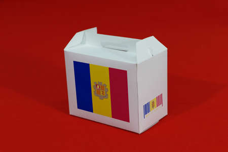 Andorra flag on white box with barcode and the country color flag on red background. The concept of export trading from Andorra, paper packaging for put products. Stok Fotoğraf