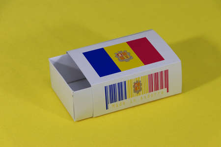 Andorra flag on white box with barcode and the color of country flag on yellow background, paper packaging for put match or products. The concept of export trading from Andorra.