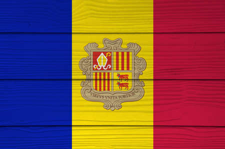 Andorra flag color painted on Fiber cement sheet wall background. A vertical tricolor of blue yellow and red with the National Coat of Arms on the center.
