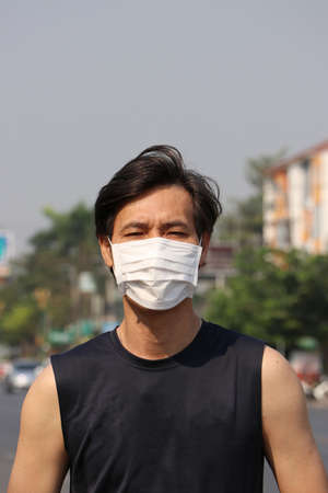 Masked Asian man prevent germs. concept of virus corona or Tiny Particle protection. Stok Fotoğraf