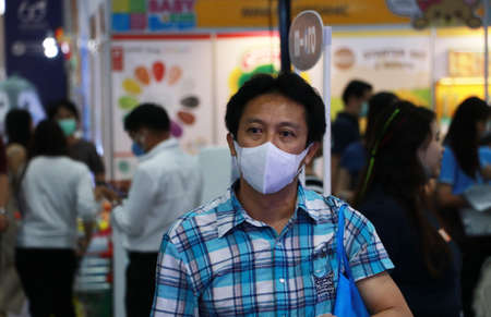 Nonthaburi, Thailand-Jan 31, 2020 : Masked Asian man prevent germs and walking to shopping in the market. concept of virus corona protection. Editöryel