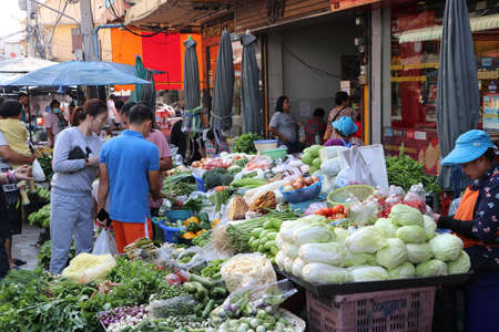 Muang, Pathum Thani, Thailand - Feb 1, 2020 : People shopping at fresh vegetable shop in the fresh food market.