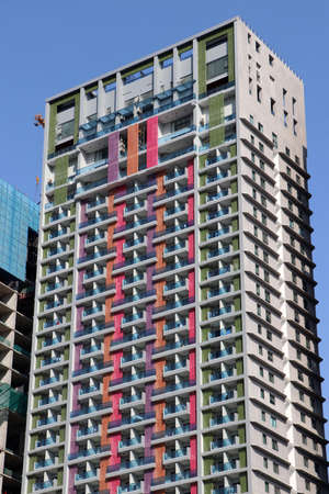 Colorful of building, exterior high tower for living on blue sky background.