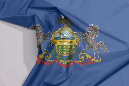 Pennsylvania fabric flag crepe and crease with white space. Coat of arms of Pennsylvania on blue field. The state of America.