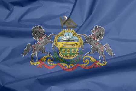 Crease of Pennsylvania fabric flag background. Coat of arms of Pennsylvania on blue field. The state of America. Stok Fotoğraf