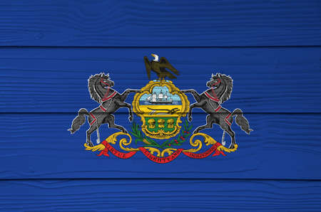 Pennsylvania flag color painted on Fiber cement sheet wall background. Coat of arms of Pennsylvania on blue field. The state of America. Stok Fotoğraf
