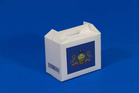Pennsylvania flag on white box and barcode on blue background. The concept of export trading from Pennsylvania. Paper packaging for put products.