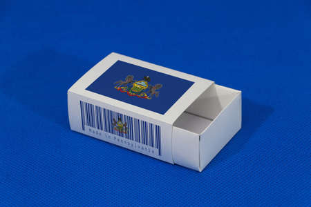 Pennsylvania flag on white box with barcode and the color of state flag on blue background, paper packaging for put match or products. The concept of export trading from Pennsylvania.