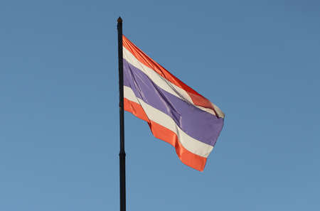 Thai National flag on bright blue sky background. Blown away by wind. Stok Fotoğraf