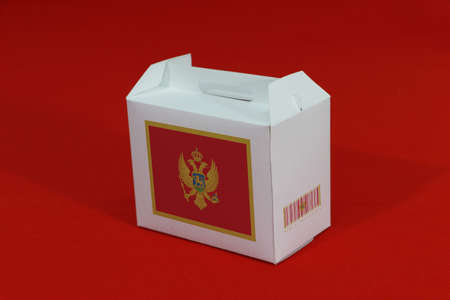 Montenegro flag on white box with barcode and the country color flag on blue background. The concept of export trading from Montenegro, paper packaging for put products.