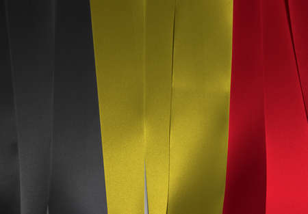 Colorful ribbon as Algeria national flag, it is a vertical tricolor of black yellow and red.  Imagens