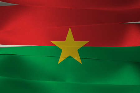 Colorful ribbon as Burkina Faso national flag, red and green and yellow star.