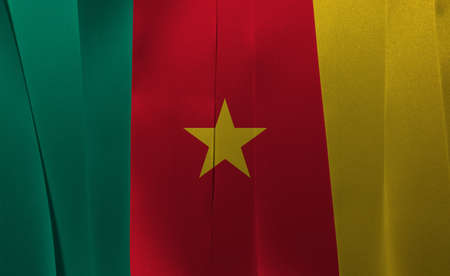 Colorful ribbon as Cameroon national flag, green red and yellow with a gold star.