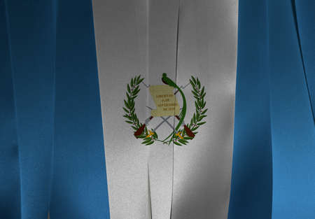 Colorful ribbon as Guatemala national flag, blue and white color with the national Emblem centered on white.