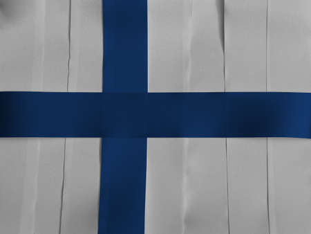 Colorful ribbon as Finland national flag, Sea blue Nordic cross on a white field. Imagens
