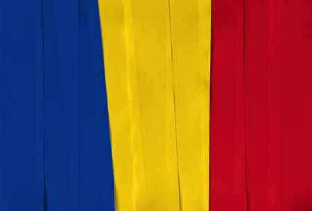 Colorful ribbon as Romania national flag, a vertical tricolor of blue yellow and red. Imagens