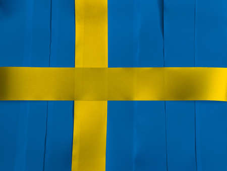 Colorful ribbon as Sweden national flag, it is consists of a yellow or gold Nordic Cross on a field of blue. Imagens