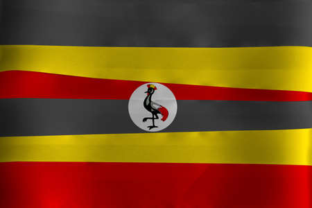 Colorful ribbon as Uganda national flag, black yellow and red ; a white disc depicts the national symbol, a grey crowned crane. Imagens