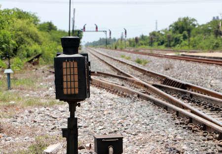 Signal lamp shunting railroad tracks. Installed beside the railway.