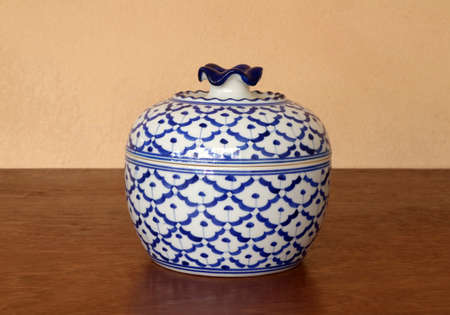 """Big ceramic side dish bowl """"pineapple pattern"""" white blue color isolated on wooden table. (straight angle)"""
