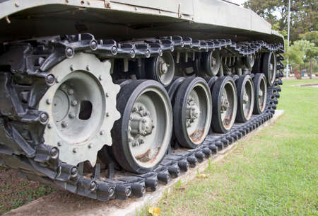 quad tracked tank on the green lawn. Can be driven in all terrain. Archivio Fotografico - 157449772