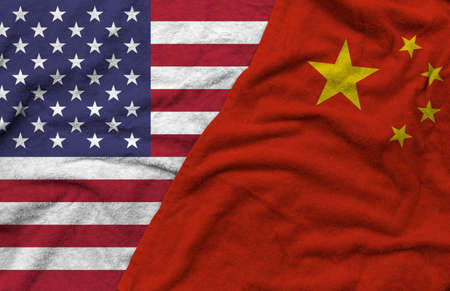 The American and Chineses flags pattern on towel fabric are placed together. It is the concept of the relationship between the two countries.