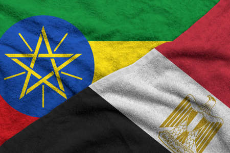 The Ethiopia and Egypt flags pattern on towel fabric are placed together. It is the concept of the relationship between the two countries.