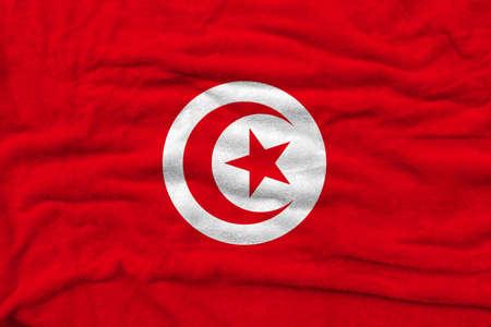 Tunisian flag pattern on towel fabric, National flag of Tunisia on fabric texture. Archivio Fotografico