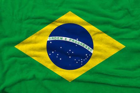 Brazilian flag pattern on towel fabric, National flag of Brazil on fabric texture.