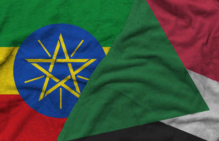 Ethiopia and Sudan flags pattern on towel fabric are placed together. It is the concept of the relationship between the two countries.
