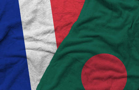 The France and Bangladesh flags pattern on towel fabric are placed together. It is the concept of the relationship between the two countries.