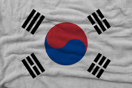 South Korean flag pattern on towel fabric, National flag of South Korea on fabric texture.
