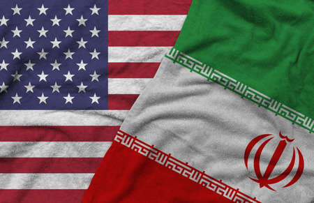 The American and Iran flags pattern on towel fabric are placed together. It is the concept of the relationship between the two countries. Archivio Fotografico