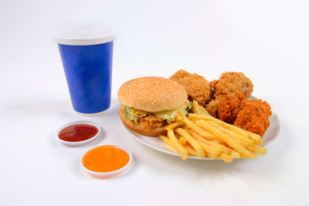containing: Fast food set containing burgers, fried chicken, french fries and soft drink isolated on white background.