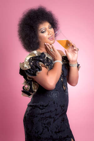 Fat man makeup his face and wear women dress look like transvestite on pink background.(Drag queen fashion concept)