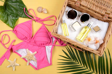Summer and sunscreen, Beauty cosmetics product for skin care and women accessories on the beach. (Sun protection product concept) Stock Photo