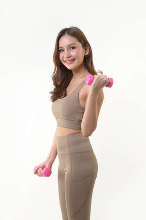 Asian woman exercising with dumbbells for good healthy on white background.