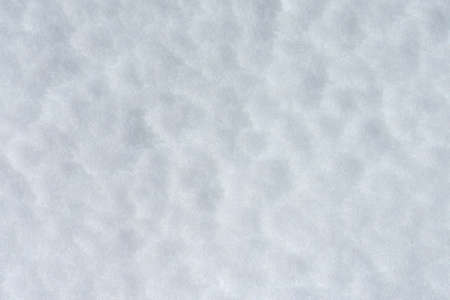 Top view of the fresh snow texture. Snow background. Imagens