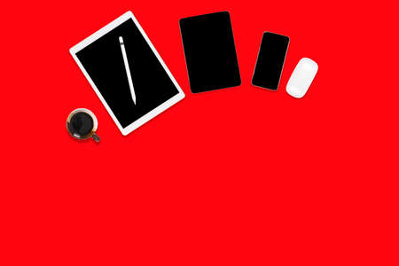 Flat lay of office table with digital tablet, mobile phone and accessories.