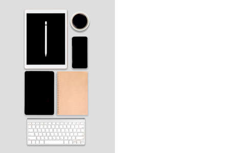 Flat lay photo of office table with laptop computer, digital tablet, mobile phone and accessories. on modern tone background. Desktop office mockup concept.