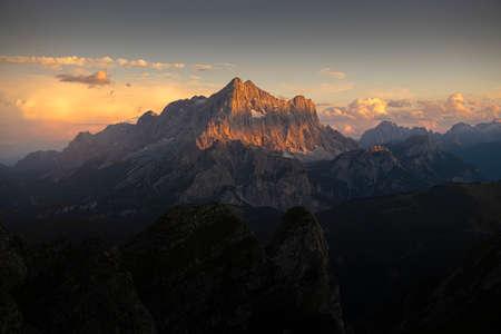 Landscape mountain peak on sunset.