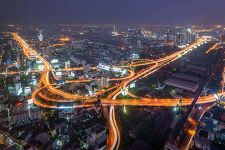 Aerial view of road interchange or highway intersection at night. Editorial