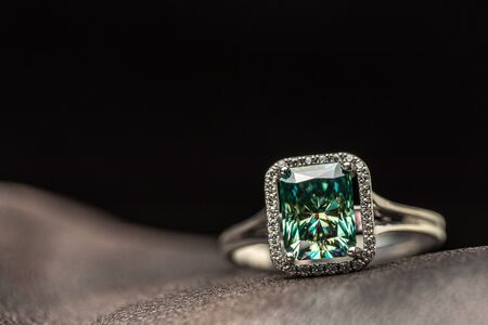 Emerald Halo Ring on Leather