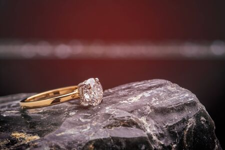 Gold Diamond Ring on Black Stone