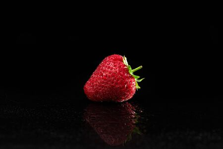 Fresh Strawberry on Reflected Wet Table