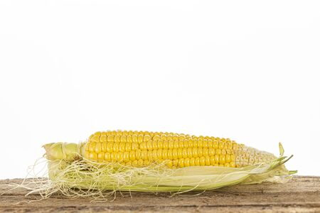 Fresh Corn on Wooden Table Isolated on White Background