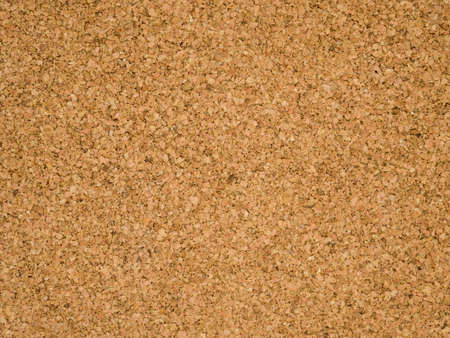 Cardboard wall. Plywood. Corkboard background. Brown paper texture. Abstract pattern. Wood backdrop. Untreated cork panel